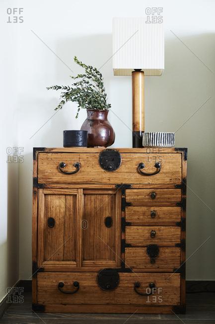 Wooden nightstand in a bedroom