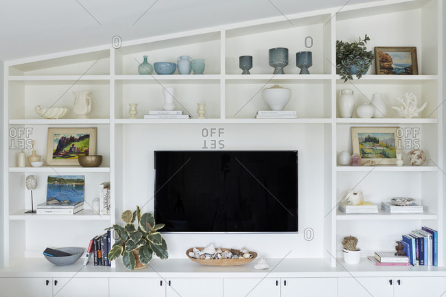 Los Angeles, CA - January 11, 2019: Large television surrounded by built in white shelving