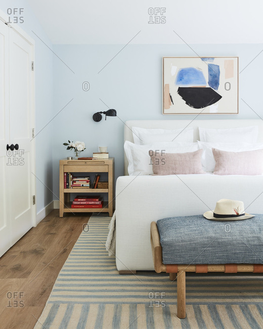 Los Angeles, CA -  January 12, 2019: Modern bedroom with light blue walls