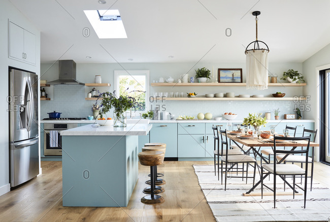 Los Angeles, CA -  January 11, 2019: Bright modern kitchen with blue cabinetry