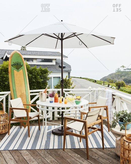 Los Angeles, CA - January 12, 2019: Deck with table, chairs and surfboard