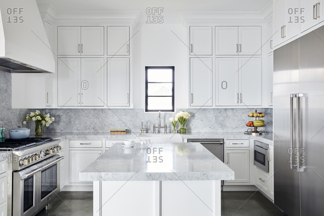 Los Angeles, CA - February 9, 2019: Beautiful bright modern kitchen with stainless steel appliances