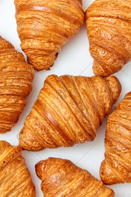 Close up view of homemade delicious French croissants on a light gray background. Top view. Concept of breakfast continental.