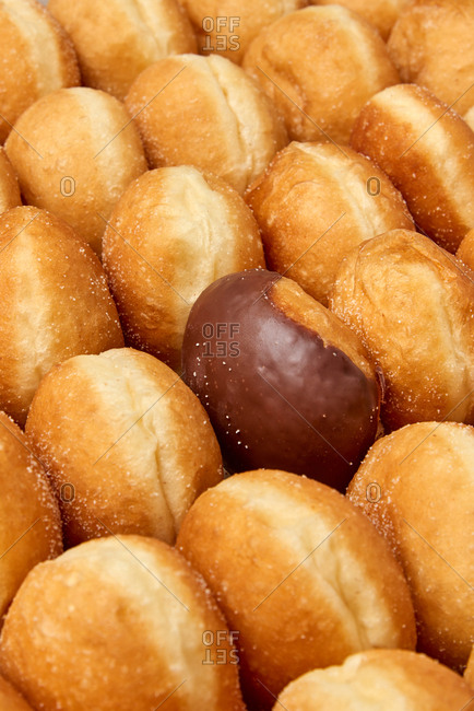 Food baking background of fresh delicious doughnuts with one chocolate glazed. Food baking background.