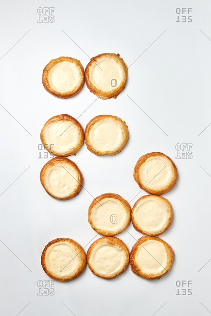 Delicious fresh homemade cheese cakes on a light gray background with copy space. Top view.