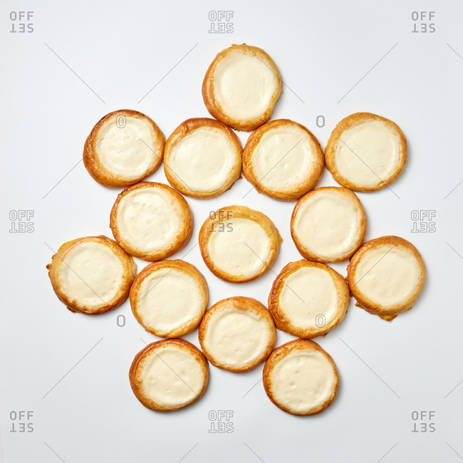 Top view of tasty homemade freshly baked cookies filled vanilla cheese cream on a light gray background. Copy space. Flat lay.