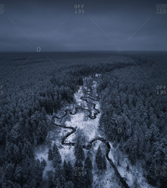 Aerial view of a river in the snowy landscape in Estonia.