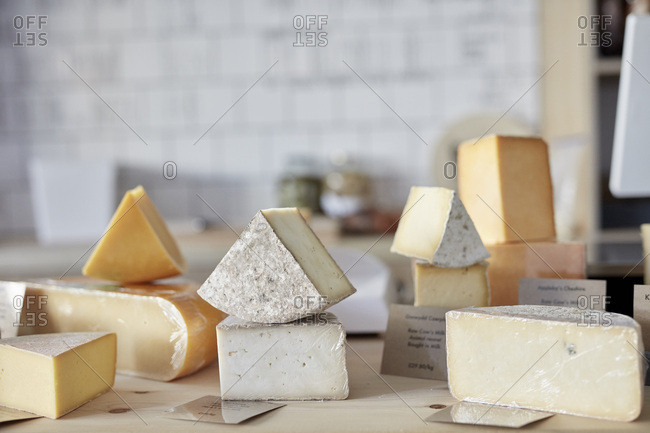 Selection of cheeses on counter in shop