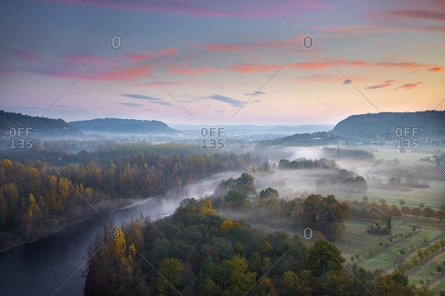 Aerial view of the Dordogne Valley & Dordogne river on a misty morning in autumn, Lot, Midi-Pyrenees, France