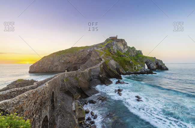 Spain, Basque country, San Juan de Gaztelugatxe, view of islet at sunset