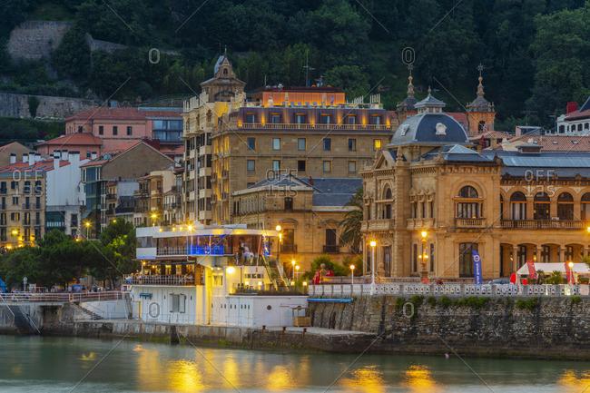 July 6, 2018: Spain, Basque Country, San Sebastian (Donostia),  City hall and old town illuminated at night