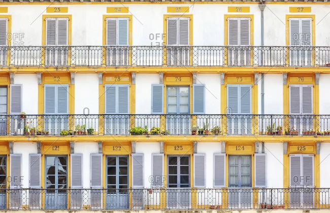 July 6, 2018: Spain, Basque Country, San Sebastian (Donostia), Plaza de la Constitution, close up of typical balconies