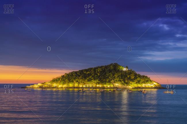 Spain, Basque Country, San Sebastian (Donostia), Santa Clara Island and the Concha Bay illuminated at night