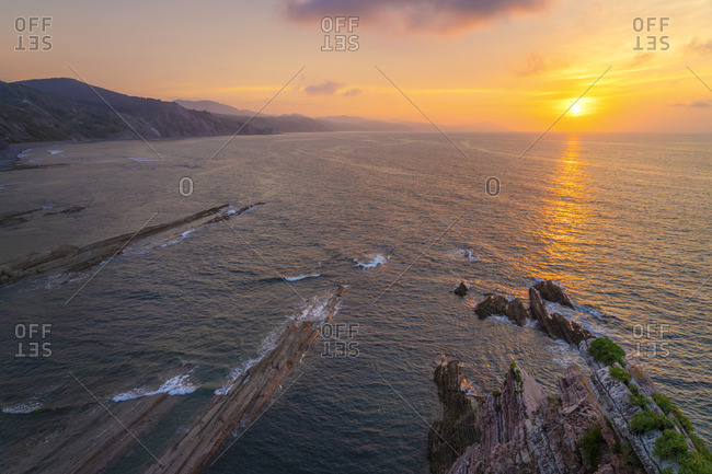 Spain, Basque Country, Zumaia. Falaises de Flysch at sunset