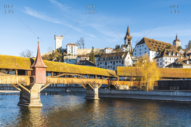 Lucerne, Switzerland. Old wooden bridge over Reuss river and fortified walls
