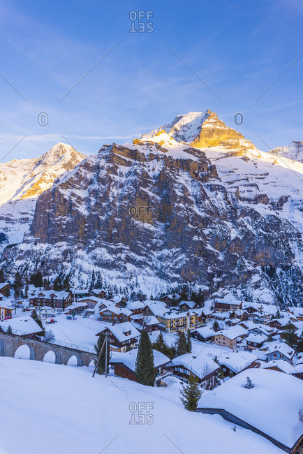 February 13, 2019: Murrin, Berner Oberland, canton of Bern, Switzerland. The village with M�nch and Jungfrau in the backdrop