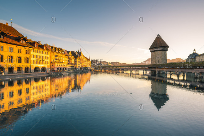 February 17, 2019: Lucerne, Switzerland. Kapellbr�cke (Chapel Bridge) and water tower on Reuss river at sunrise