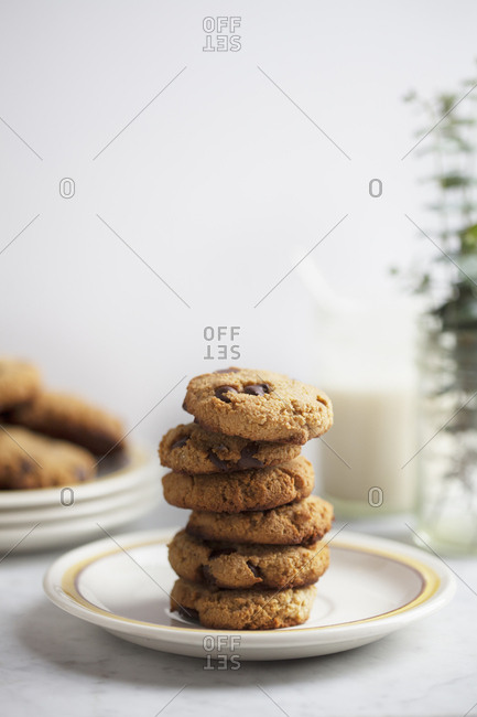 Stack of coconut and chocolate chip cookies on a small plate