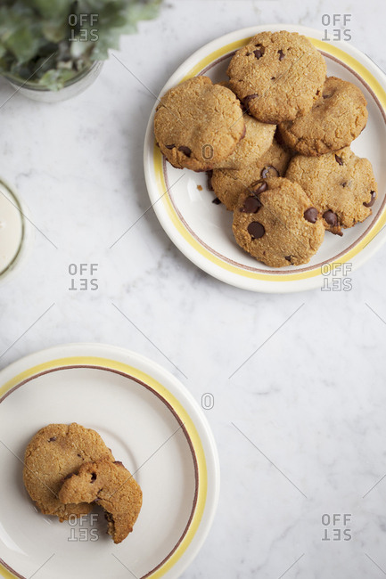 Coconut and chocolate chip cookies on small plates