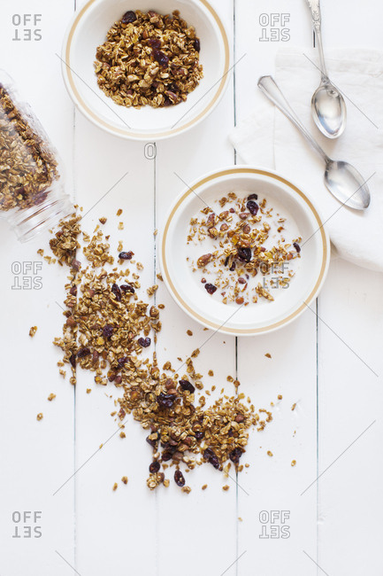 Two bowls of granola on a wooden table