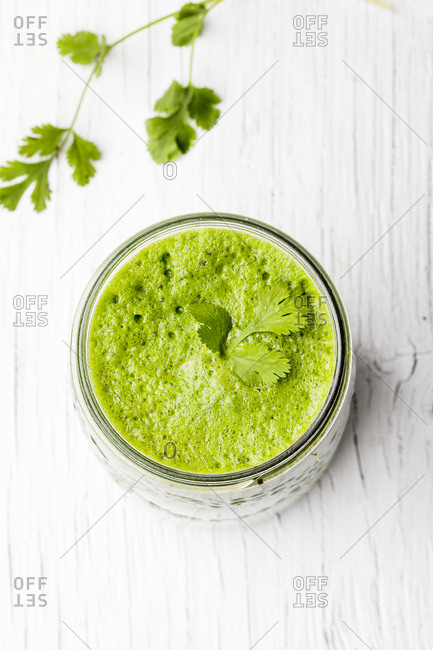 Green juice with fresh parsley in a glass jar