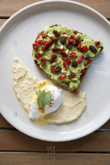 Avocado toast with hummus and poached egg