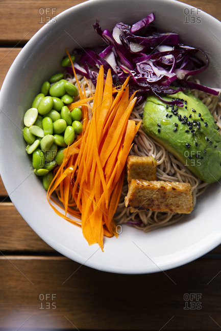Noodle bowl with tofu, black sesame, and vegetables