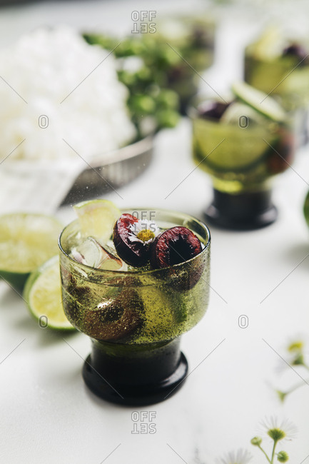 Refreshing mock cocktail with cherries and edible flowers