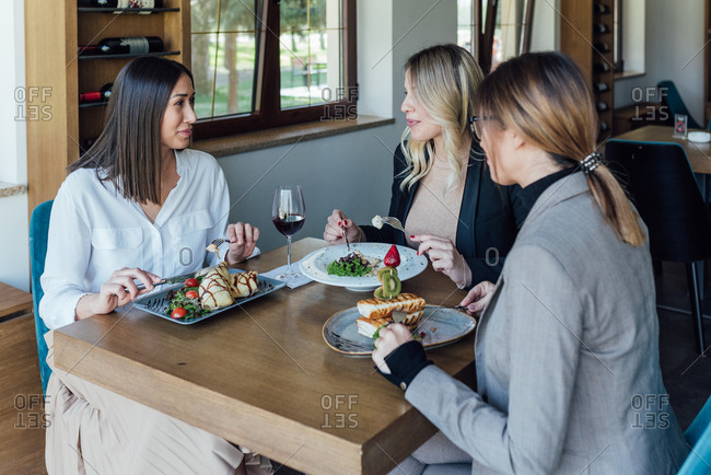 Three businesswomen have a lunch meeting