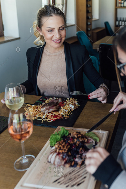 Businesswomen have lunch together at a restaurant