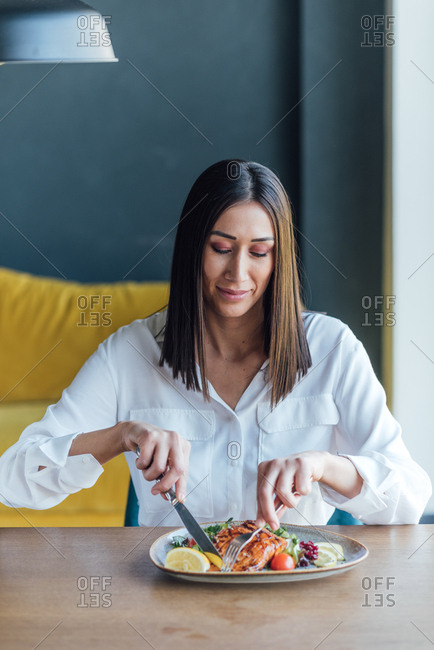 Beautiful brunette woman eats a heathy lunch