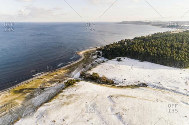 Aerial view of sand dunes on sea coast