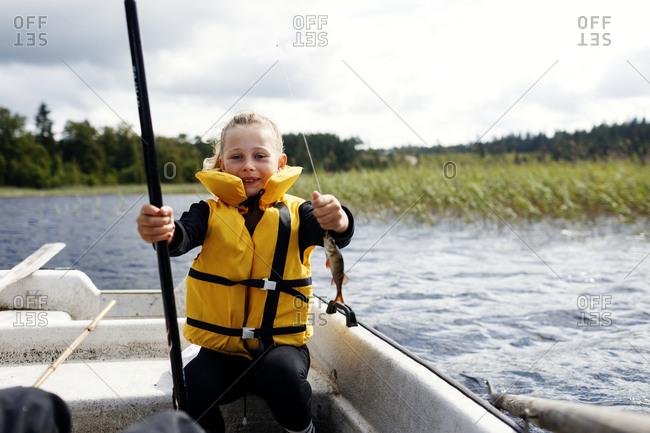 Boy fishing on lake - Offset