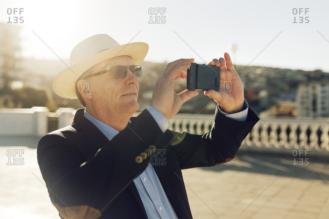 Man taking picture with cell phone