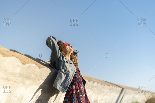 Happy young woman enjoying sunlight