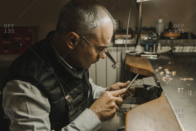 Artisan making jewelry in his workshop