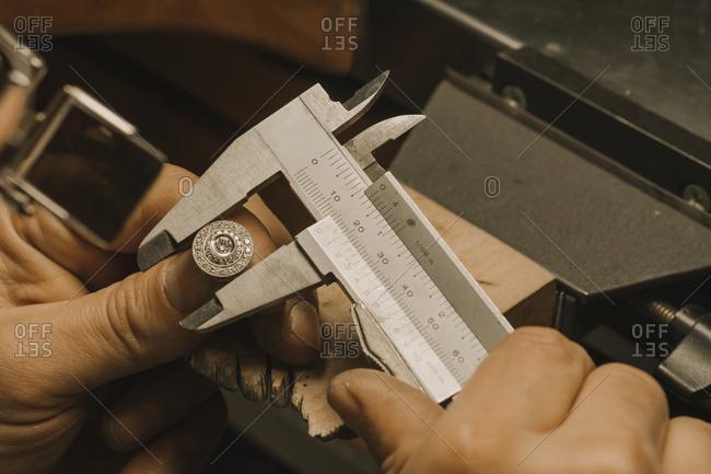Artisan making jewelry- fixing ring