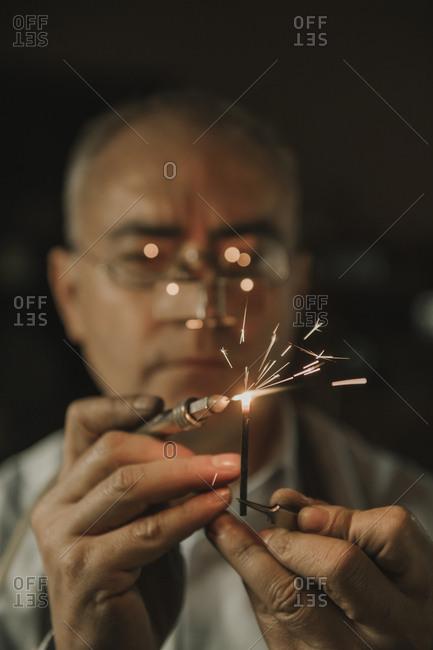 Artisan soldering precious metal- portrait