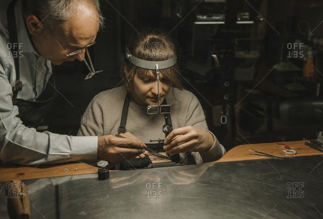 Artisan and his coworker making jewelry in his workshop