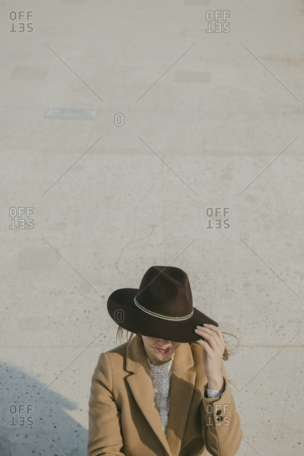 Young hipster woman with a hat
