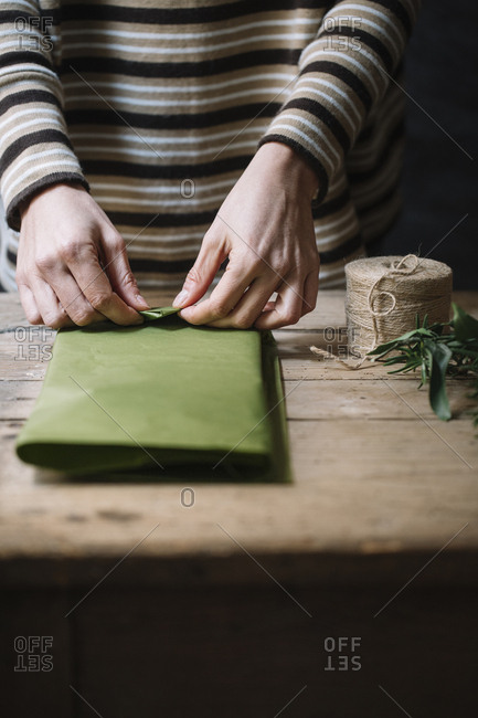 Woman's hands wrapping present - Offset