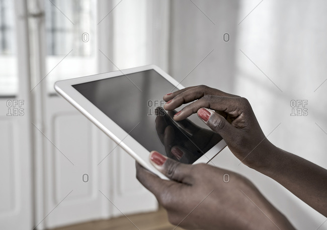 Woman's hands using digital tablet- close-up
