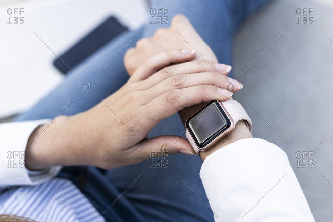 Businesswoman checking smart watch- close up