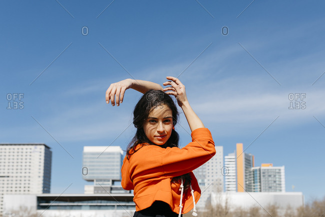 Young contemporary dancer wearing red hoodie shirt- practicing