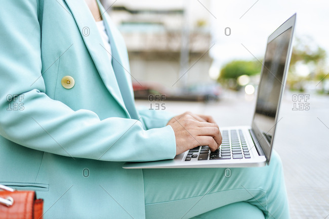 Close-up of woman's hands using laptop