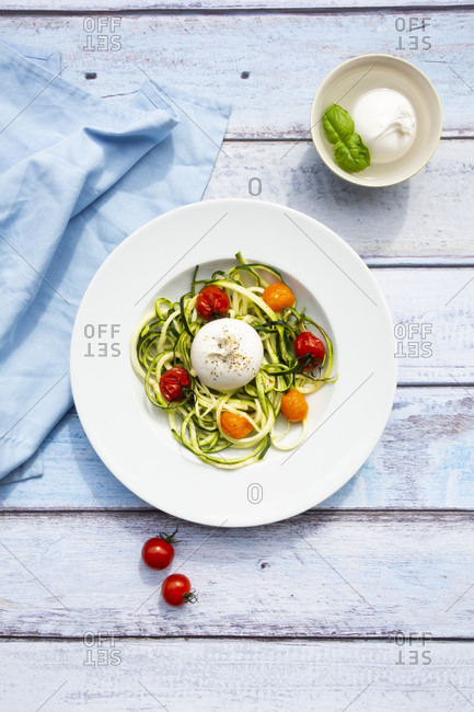 Zucchini noodles with baked tomatoes- burrata cheese- pepper and olive oil
