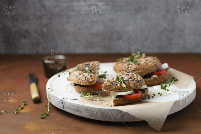 Bagels with sesame pesto- tomatoes- onions and thyme