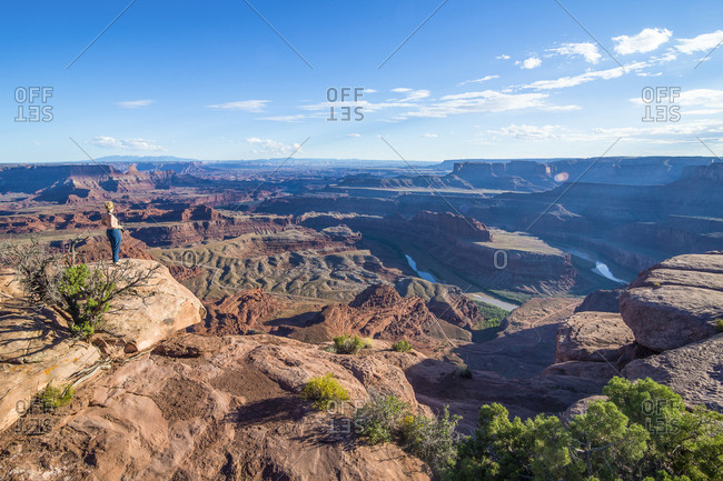USA- Utah- Woman at a overlook over the canyonlands and the Colorado river from the Dead Horse State Park