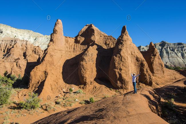 USA- Utah- Woman standing before redrock sandstone formations in the Kodakchrome Basin State Park-