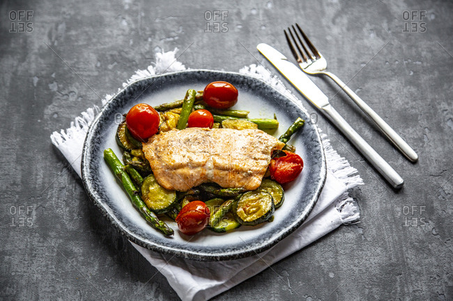 Coalfish fillet on zucchini- green asparagus and tomato- low carb